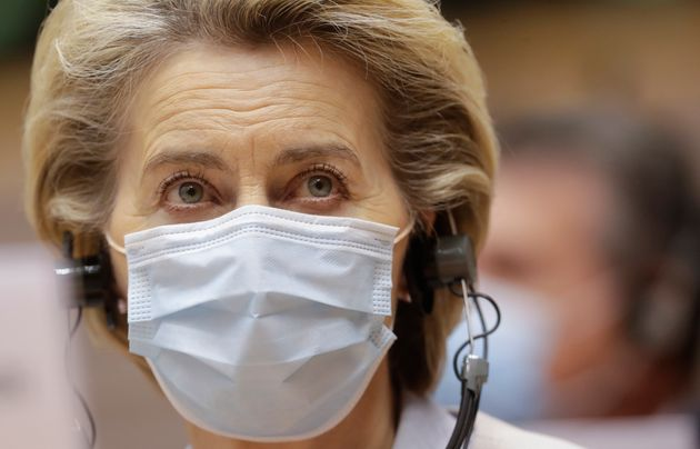 European Commission President Ursula von der Leyen wears a protective face mask prior to addressing a...