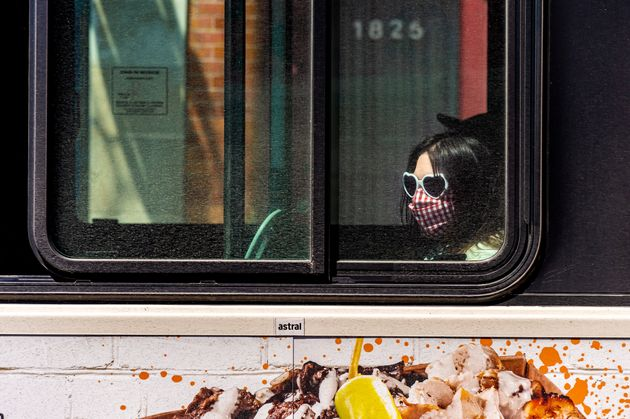 Montreal, CA - 20 May 2020: STM Bus passenger with face mask during Covid 19