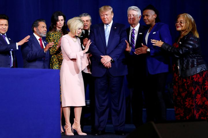 President Donald Trump participates in a prayer before speaking at an Evangelicals for Trump coalition launch at the King Jes
