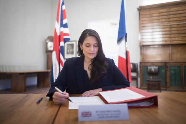 Home Secretary Priti Patel signs a new agreement with her French counterpart Gerald Darmanin aimed at...