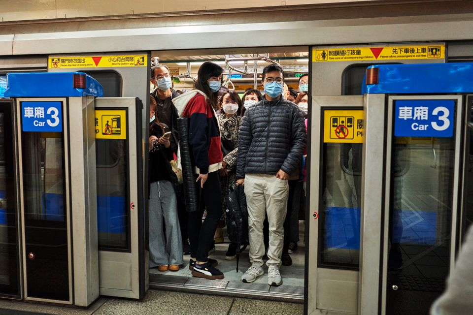 Commuters wear face masks in Taiwan, which has seen more than 200 days without a single recorded case...