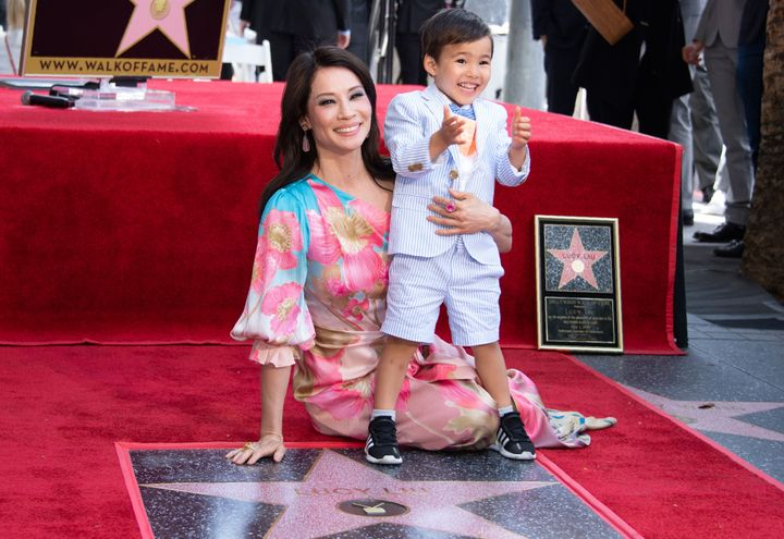 Lucy Liu and her son Rockwell Lloyd smile as she receives her star on the Walk of Fame during a ceremony in Hollywood in May 2019.