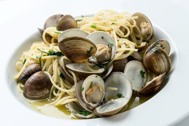 Spaghetti pasta and fresh clams sauteed with olive oil, garlic, white wine, parley and grounded black
