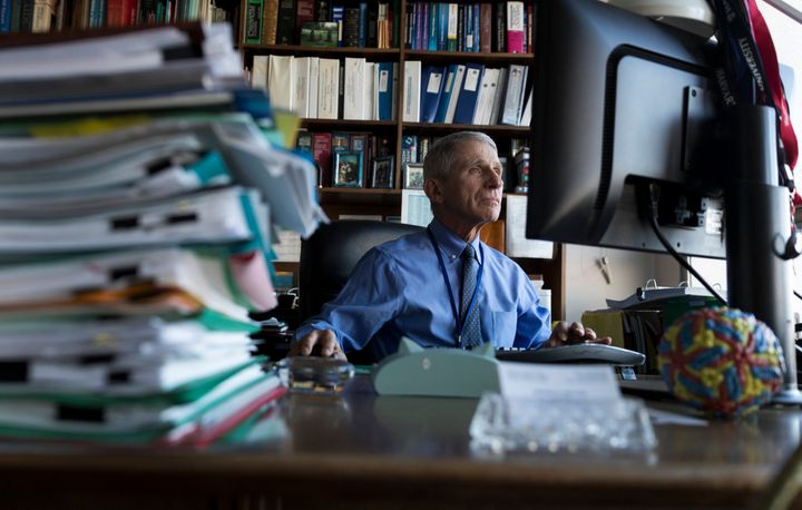 Dr. Anthony Fauci, director of the National Institute for Allergy and Infectious Diseases, works in his office at the National Institutes of Health on Dec. 19, 2017, in Bethesda, Maryland.