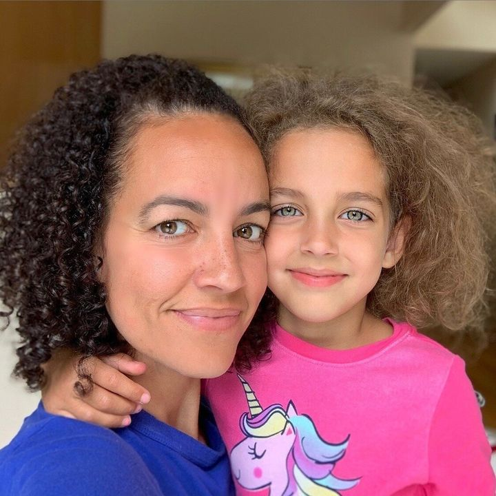 Letting my hair down with my youngest daughter who shares the same head of curls.
