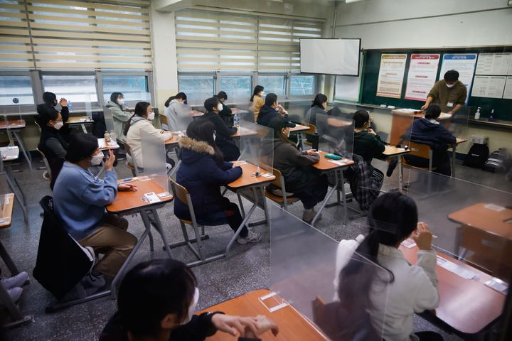 South Korea is pressing ahead with nationwide standardized tests despite rising coronavirus cases.