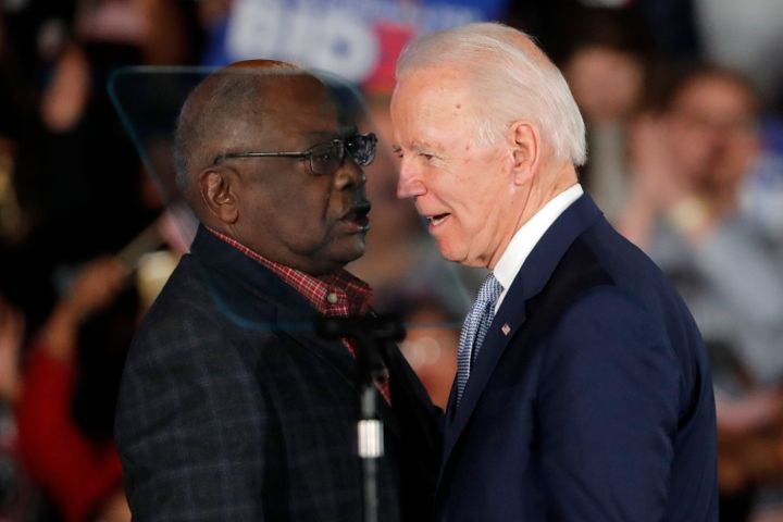 Joe Biden talks to Rep. James Clyburn (D-S.C.) at a primary night election rally after winning the South Carolina primary, wh