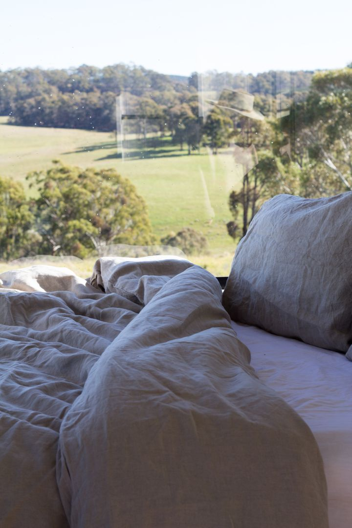 Curl up in Carlotta + Gee linens and enjoy the view from The Daisy House in the Blue Mountains.