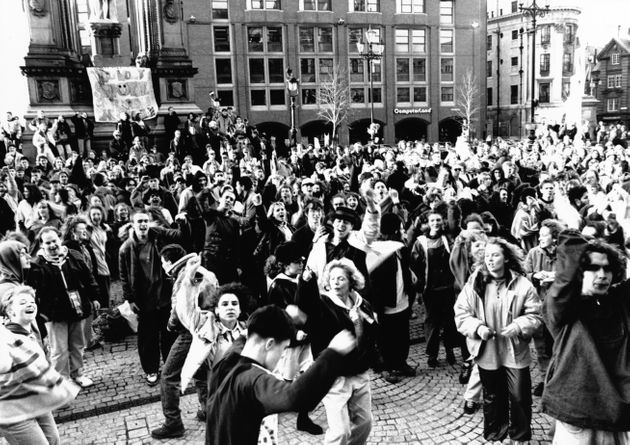 Hundreds of protesters hold a huge acid house party in Albert Square, Manchester in protest against police...