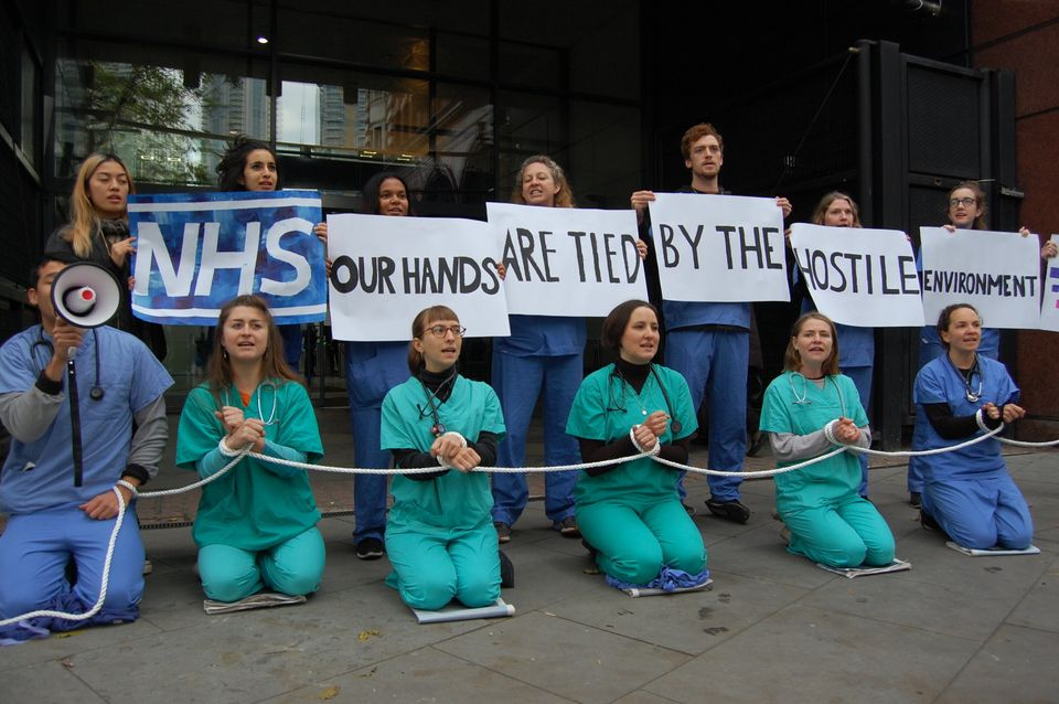Medical staff protesting against the NHS' upfront charging policies, introduced as part of the hostile...