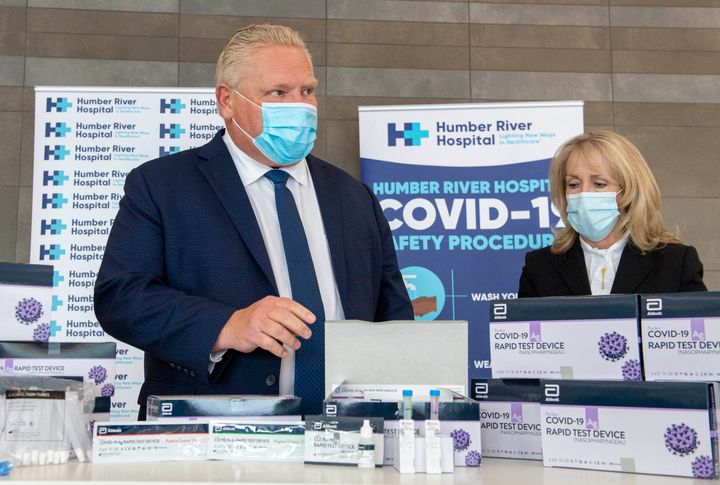Ontario Premier Doug Ford and Long-Term Care Minister Merrilee Fullerton are briefed on rapid COVID-19 test kits at Humber River Hospital in Toronto on Nov. 24, 2020.