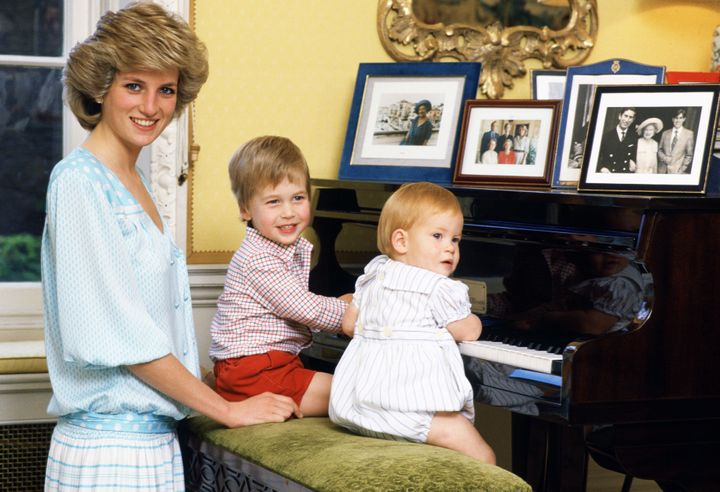 The Princess of Wales with her sons, William and Harry, at the piano in Kensington Palace.