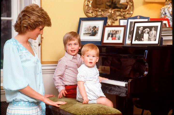 Diana gazes adoringly at her little ones.