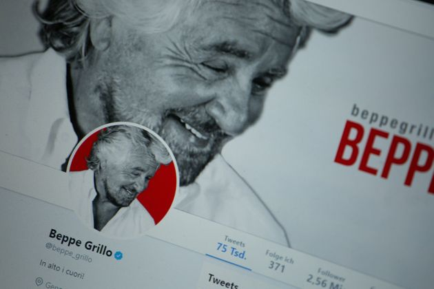 The twitter profile of Beppe Grillo is seen on a screen. (Photo by Alexander Pohl/NurPhoto via Getty
