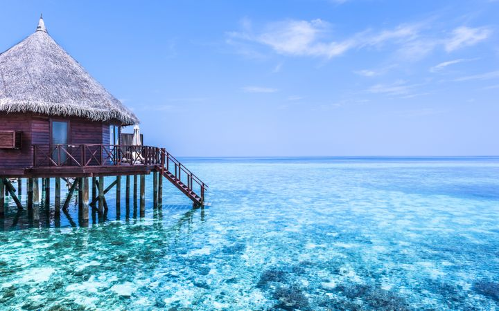 Part of the water bungalow. Stairs down to the ocean. Rest on the sea. The output of absolute relaxation. Maldives. Tropical island resort.