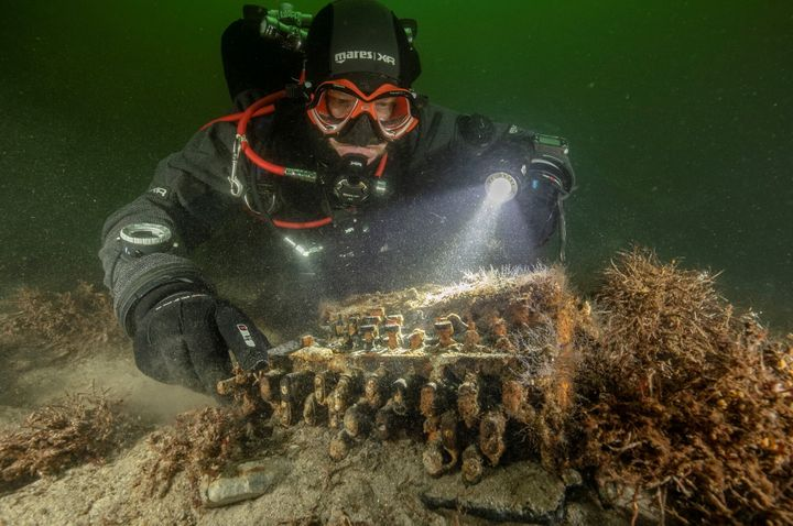 German divers searching the Baltic Sea for discarded fishing nets have stumbled upon a rare Enigma cipher machine used by the
