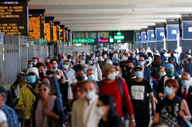 Passengers wearing protective face masks are seen at Rome's Termini train station as Italy relaxes more...
