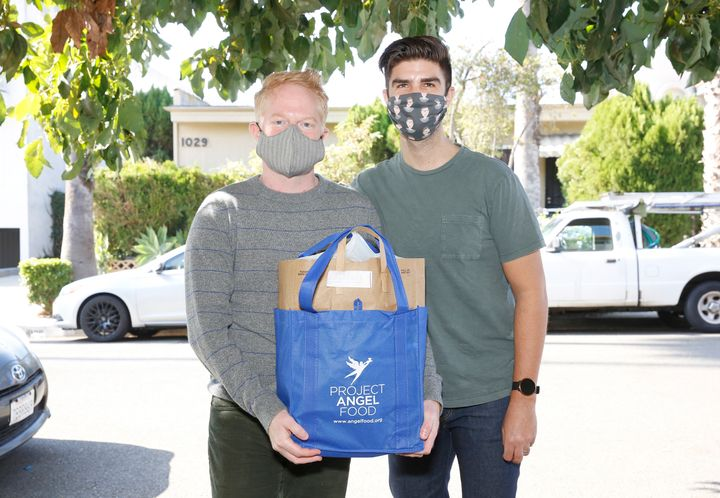 Jesse Tyler Ferguson (left) and his husband, Justin Mikita, spent Thanksgiving delivering meals to Project Angel Food clients