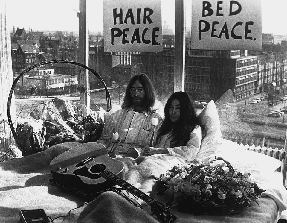 John Lennon and Yoko Ono give a press conference in bed in their Amsterdam hotel, six days after their...