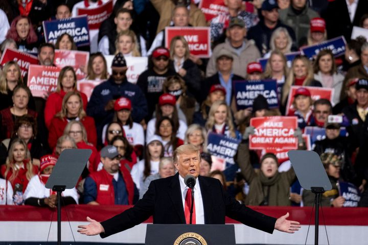 President Donald Trump addresses the crowd at a rally for U.S. Senators Kelly Loeffler, R-Ga., and David Perdue, R-Ga., who a