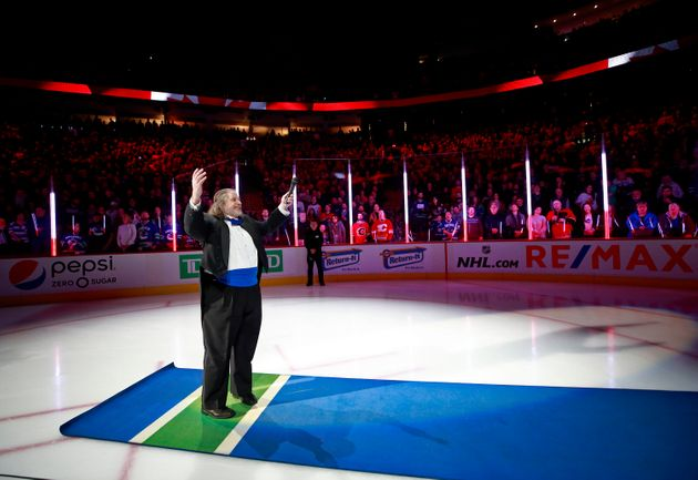Mark Donnelly sang the national anthem before the Vancouver Canucks played the Calgary Flames in Vancouver...