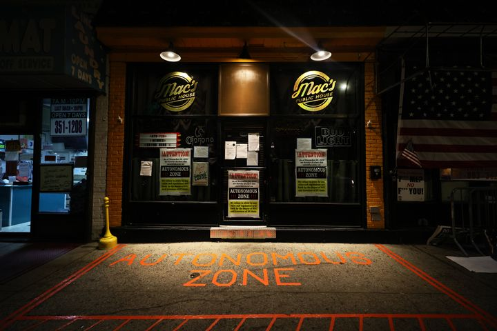 "The words ""Autonomous Zone"" are displayed at the entrance of Mac's Public House whose owner and manager are refusing to"