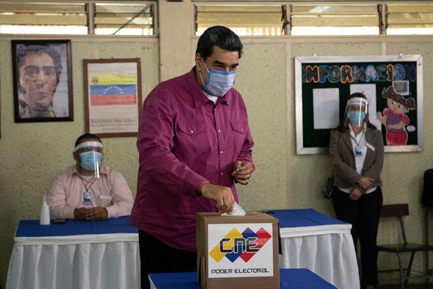 CARACAS, VENEZUELA - DECEMBER 06: Nicolas Maduro, Venezuela's President puts his vote into a ballot at...