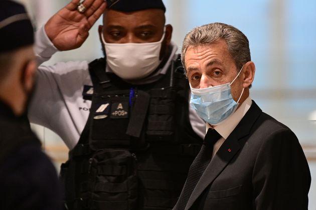 Nicolas Sarkozy, poursuivi pour corruption et trafic d'influence, arrivant à la 32e chambre correctionnelle...