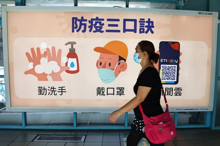 A woman wears a face mask at a metro station in Taipei, Taiwan, Nov. 18, 2020.