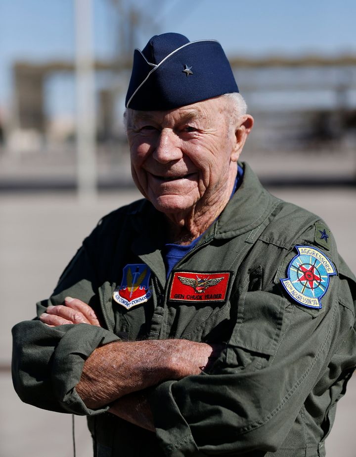 Retired Air Force Brig. Gen. Charles Yeager talks to the media following a reenactment flight commemorating his breaking of t