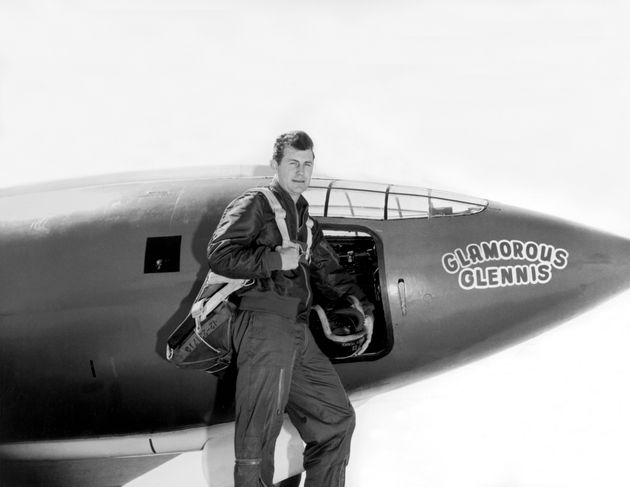 Captain Charles E Yeager standing next to the Air Force's Bell X-1 supersonic research aircraft, Muroc...