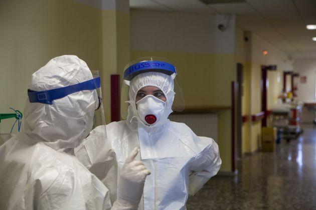 BARI, ITALY - OCTOBER 22: Nurses talk during their shift at Bari Hospital on October 22, 2020 in Bari,...