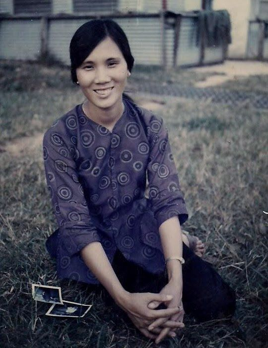 The writer's mother in Vietnam, approximately around 21 years of