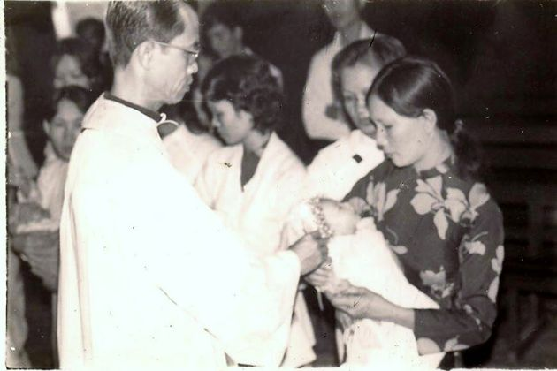 The writer, two months old at the time, is baptized held in her mother's