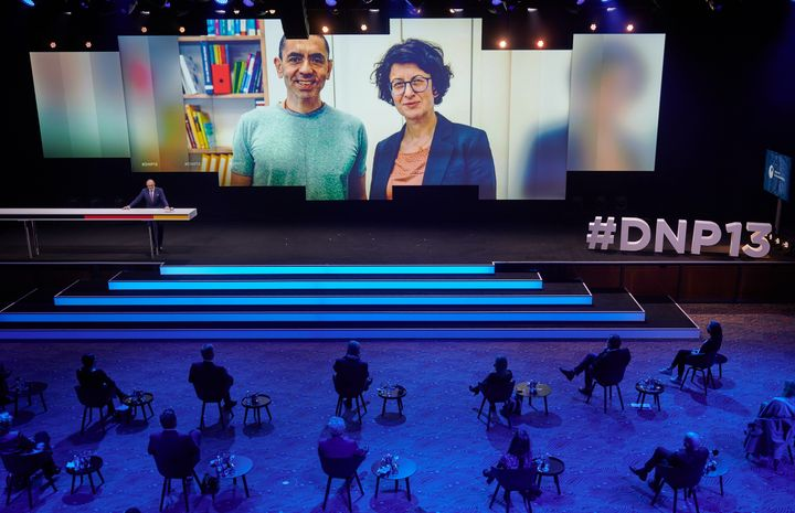 Özlem Tureci (l) and Ugur Sahin (r) shown on screen during an awards ceremony in early December.