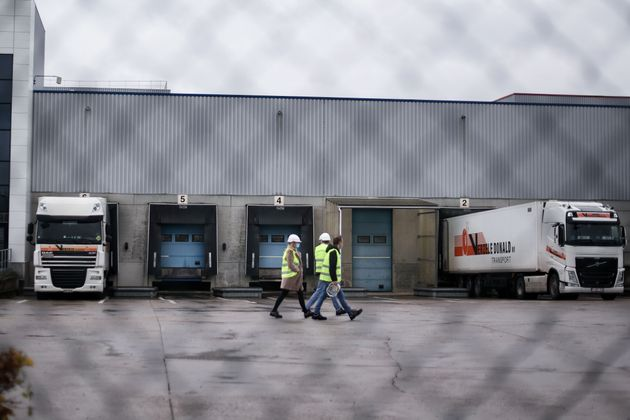 Trucks are loaded at a Pfizer factory in Puurs, Belgium where Covid-19 vaccines are being produced for Britain.