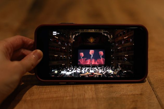 MILAN, ITALY - DECEMBER 07: A smart phone displays the orchestra at the premiere of the Teatro alla Scala...
