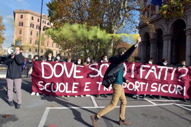 ROME, ITALY - DECEMBER 05: Students protest in front of the Ministry of Transport to demand safe return...