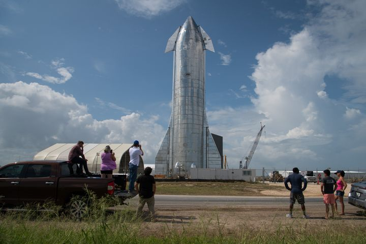 Space enthusiasts look at a prototype of SpaceX's Starship spacecraft at the company's Texas launch facility on September 28,