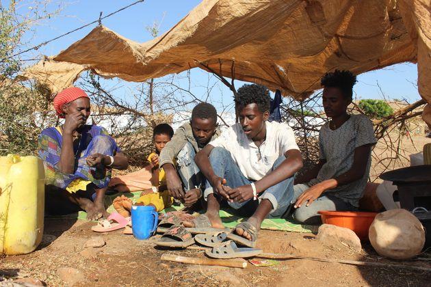 A family of five take shelter in Um-Rakoba camp,