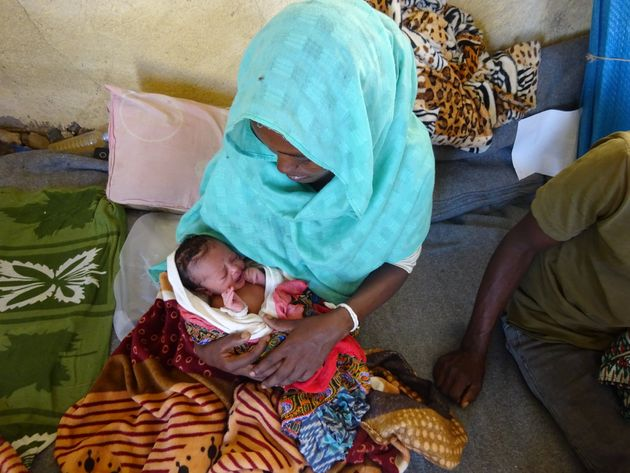 Barakhti, 27, with her baby at Village 8