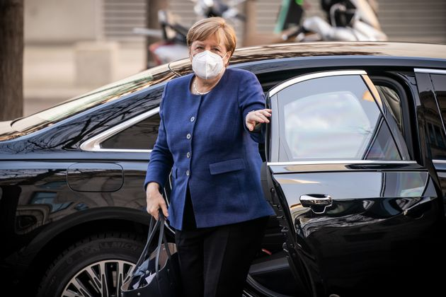 08 December 2020, Berlin: Chancellor Angela Merkel (CDU), arrives at the Bundestag at the beginning of...