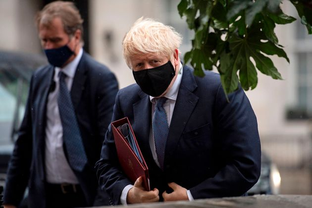Britain's Prime Minister Boris Johnson wears a protective face covering as he arrives at the BBC in central...