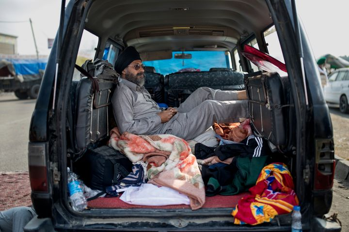 Savek Singh, 48, rests inside his vehicle parked on a highway as he joins a farmers protest at the Delhi-Haryana state border, India, on Dec. 1, 2020.