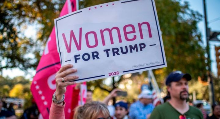 """A woman holds a """"Women For Trump"""" sign at a protest in Austin, Texas, on Nov. 7."""
