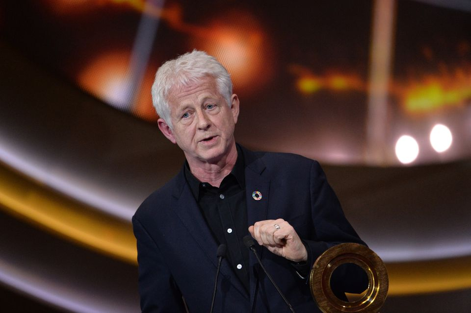 Richard Curtis wrote The Vicar Of Dibley with Paul