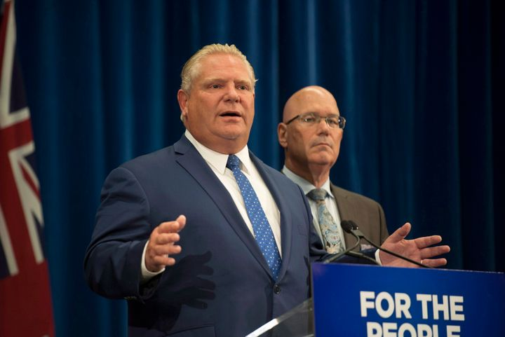 Ontario Premier Doug Ford speaks to reporters with Minister of Municipal Affairs and Housing Steve Clark in Toronto on Sept. 10, 2018.