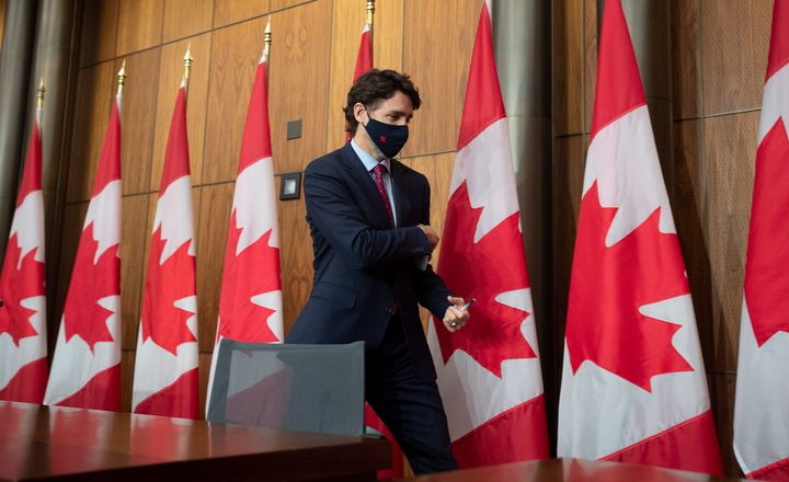 Prime Minister Justin Trudeau leaves a news conference in Ottawa, Monday, Dec. 7, 2020.  (Adrian Wyld/The Canadian Press via
