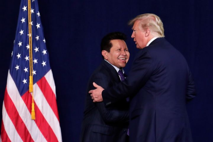 President Donald Trump embraces Guillermo Maldonado during a rally of evangelical supporters at the King Jesus International