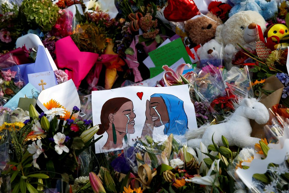 Flowers and cards are seen at the memorial site outside Al Noor mosque in Christchurch, New Zealand on...